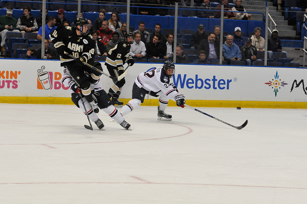 Freshman forward Marco Richter looks to stop the puck during UConn's 2-0 loss against Army on Nov. 10, 2015. The Huskies are in the midst of an eight game losing streak. (Amar Batra/The Daily Campus)