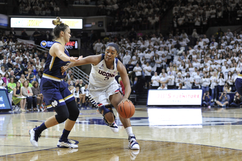 UConn women's basketball redshirt junior forward Morgan Tuck dribbles the ball during the Huskies' game against No. 3 Notre Dame at Gampel Pavilion in Storrs, Connecticut on Saturday, Dec. 5, 2015. (Jason Jiang/The Daily Campus)