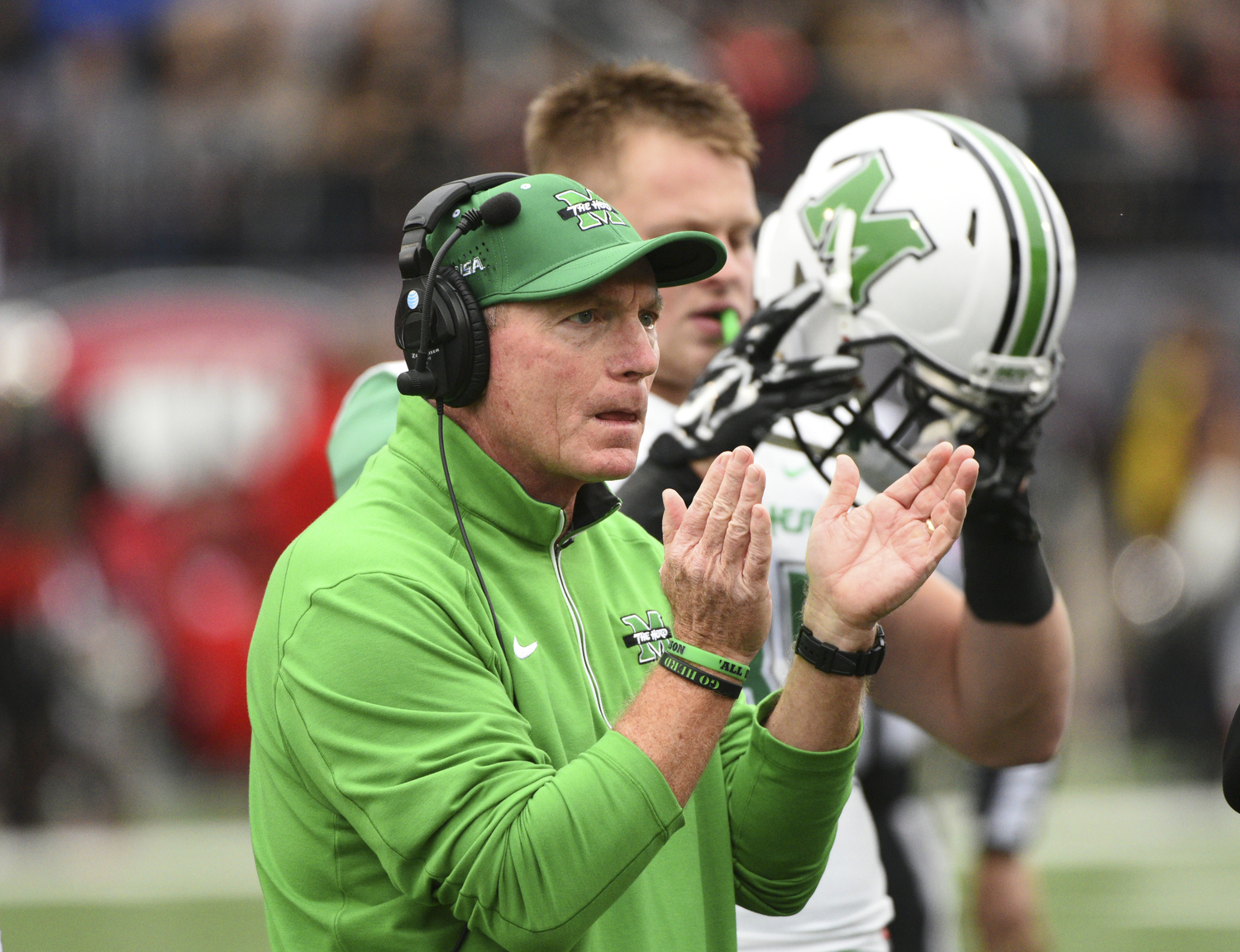 Marshall's Doc Holiday claps for his players during the first half of an NCAA college football game against Western Kentucky on Friday, Nov. 27, 2015, at L.T. Smith Stadium in Bowling Green, Ky. (Michael Noble Jr./AP)