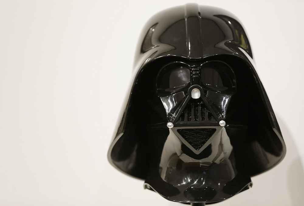 A replica of Darth Vader mask from the 'Star Wars' movie series is displayed during a press preview at Sotheby's in New York, Wednesday, Dec. 2, 2015. Sotheby's is holding an online auction of hundreds of rare and original objects associated with the space odyssey series. (AP Photo/Seth Wenig)