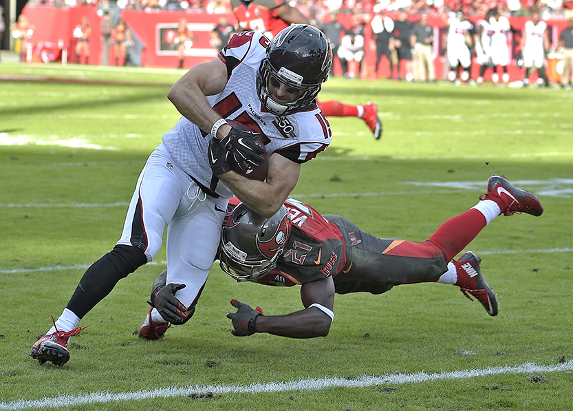 Atlanta Falcons wide receiver Nick Williams eludes Tampa Bay Buccaneers cornerback Alterraun Verner (21) as he scores on a 5-yard touchdown reception during the fourth quarter of an NFL football game Sunday, Dec. 6, 2015, in Tampa, Fla. (AP Photo/Phelan M. Ebenhack)