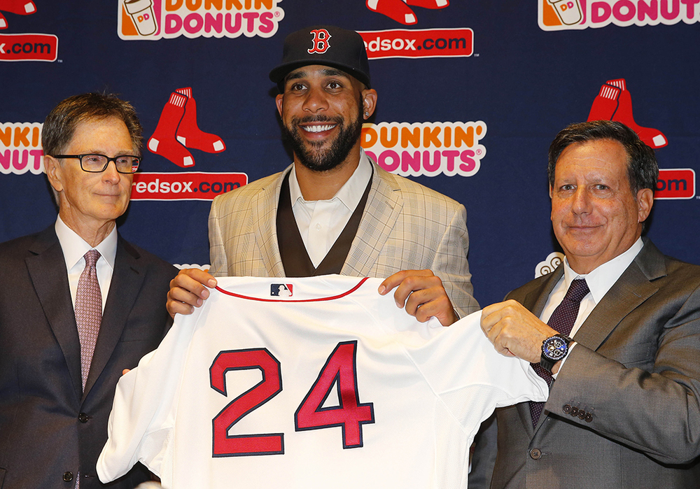 Boston Red Sox pitcher David Price, center, holds up his new jersey with principal owner John Henry, left, and chairman Tom Werner at a news conference announcing his signing by the team at Fenway Park in Boston, Friday, Dec. 4, 2015. (AP Photo/Winslow Townson)
