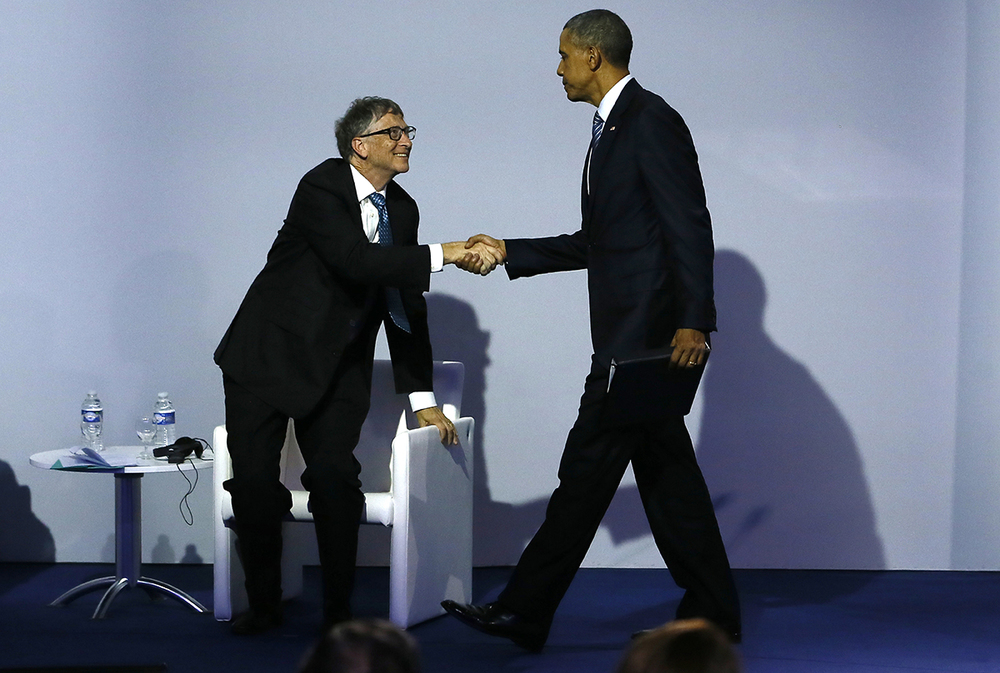 US President Barack Obama, right, shakes hands with Microsoft CEO Bill Gates during the 'Mission Innovation: Accelerating the Clean Energy Revolution' meeting at the COP2, United Nations Climate Change Conference, in Le Bourget, north of Paris, Monday, Nov. 30 2015. (AP)