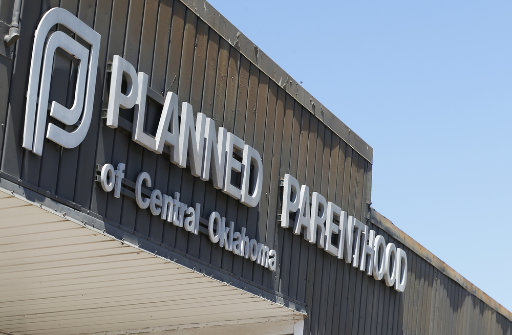 "In this July 24, 2015, file photo, a sign at a Planned Parenthood Clinic is pictured in Oklahoma City. Oklahoma Gov. Mary Fallin is urging the state's Medicaid provider to cancel its contracts with two Planned Parenthood affiliates, citing what she called a ""high rate of billing errors."" (Sue Ogrocki, File/AP)"
