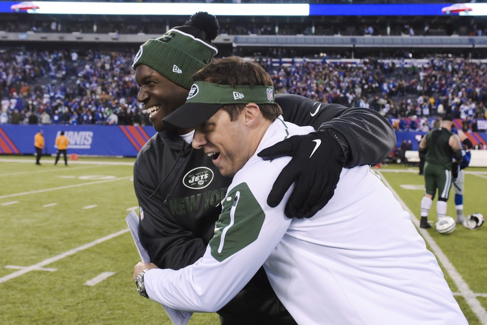 New York Jets head coach Todd Bowles, left, hugs quarterbacks coach Kevin Patullo, right, after an NFL football game against the New York Giants Sunday, Dec. 6, 2015, in East Rutherford, N.J. The Jets won 23-20. (AP Photo/Bill Kostroun)