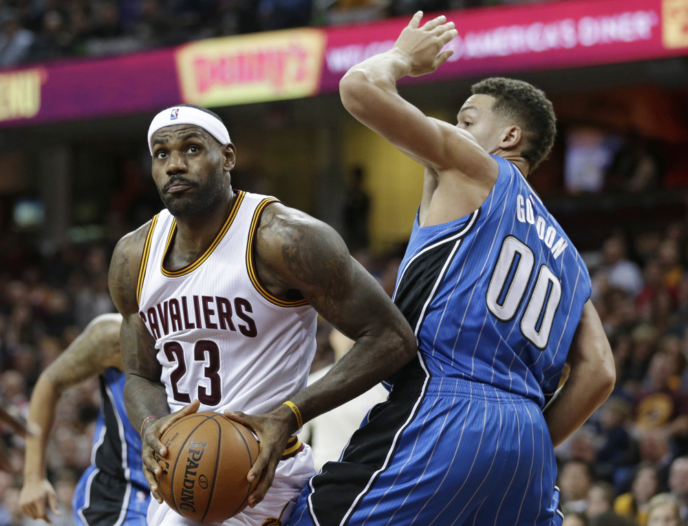 Cleveland Cavaliers' LeBron James (23) drives past Orlando Magic's Aaron Gordon (00) in the second half of an NBA basketball game Monday, Nov. 23, 2015, in Cleveland. The Cavalier won 117-103. (Tony Dejak/AP)