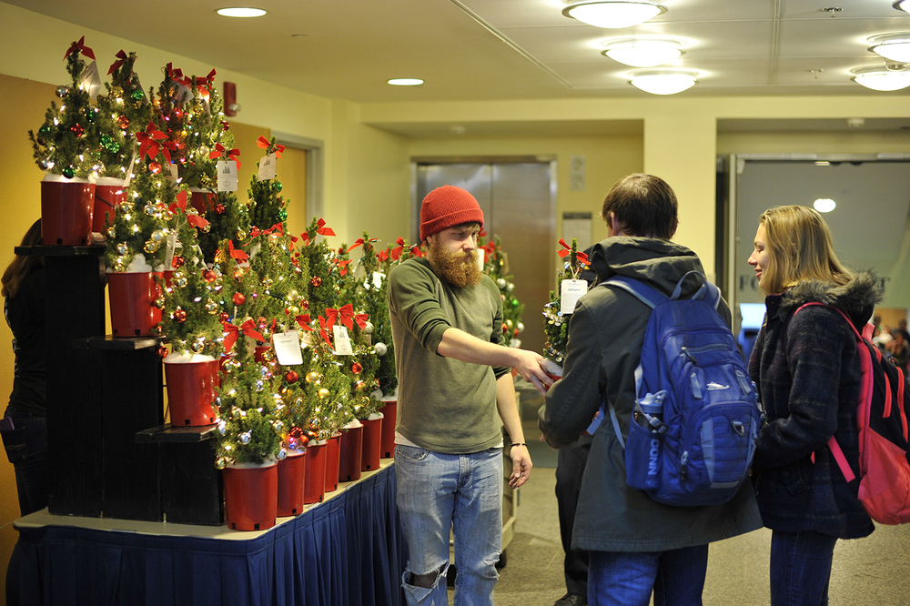 Members of the UConn Horticulture Club sell miniature decorated Christmas trees in the Student Union on Monday, Dec. 7, 2015. (Jason Jiang/The Daily Campus)