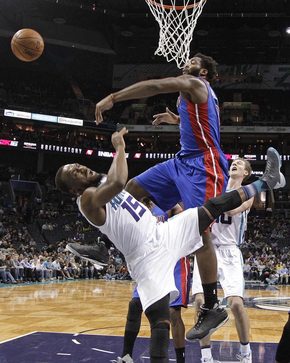 Detroit Pistons' Andre Drummond (0) blocks a shot by Charlotte Hornets' Kemba Walker (15) in the second half of an NBA basketball game in Charlotte, N.C., Monday, Dec. 7, 2015. (AP Photo/Chuck Burton)