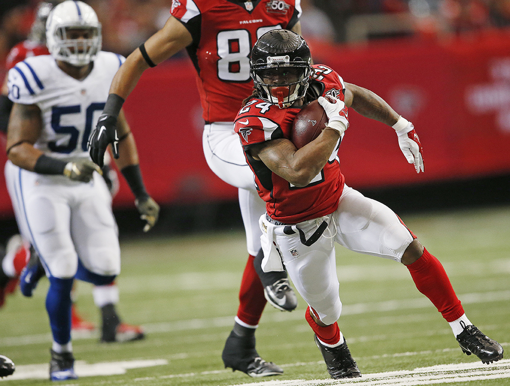Atlanta Falcons running back Devonta Freeman (24) runs against the Indianapolis Colts during the first of an NFL football game, Sunday, Nov. 22, 2015, in Atlanta. Freeman left the game due to injury. (AP Photo/John Bazemore)