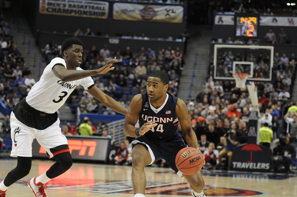 Rodney Purvis sizes up a Cincinnati defender during the American Athletic Conference tournament last spring. The Bearcats are one of several conference opponents who will threaten the Huskies this season. (File photo)