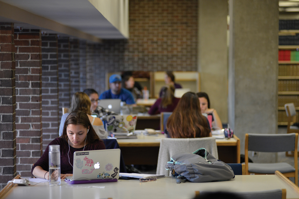 Students are seen working in the Homer Babbidge Library on UConn's Storrs campus. (Jason Jiang/The Daily Campus)