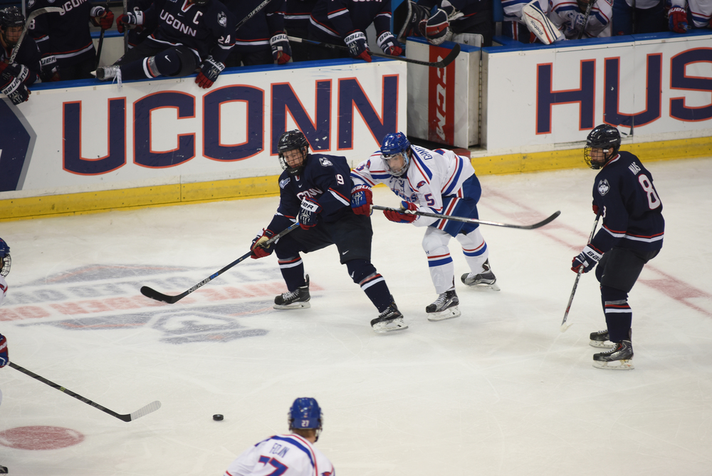 UConn junior forward Evan Richardson makes a pass during the Huskies' game against UMass-Lowell at the XL Center in Hartford, Connecticut on Dec. 5, 2015. (Allen Lang/The Daily Campus)