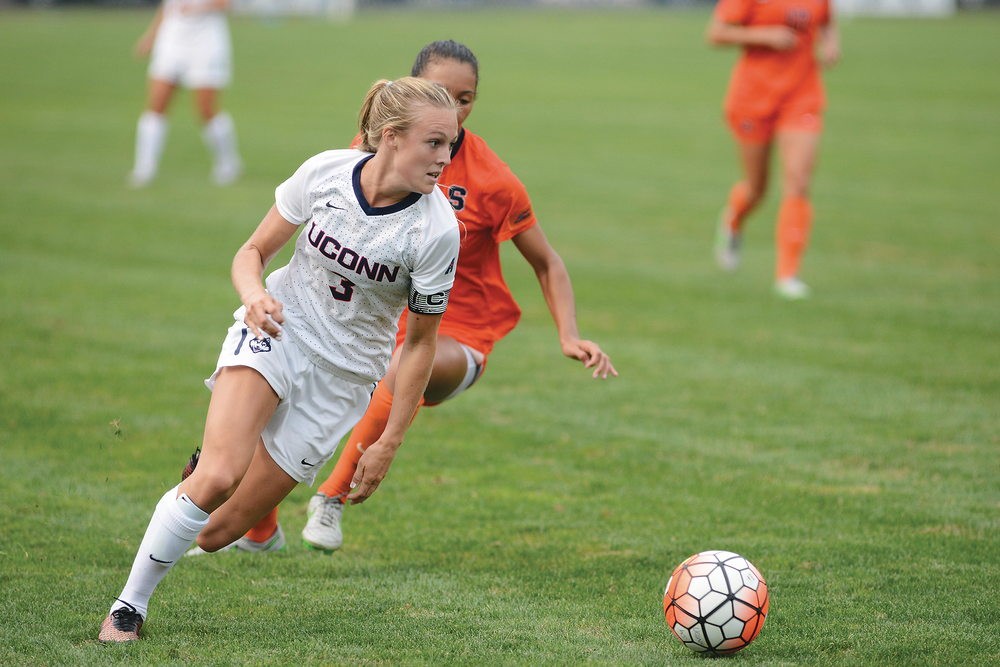 UConn junior forward Rachel Hill away from a Syracuse defender during the Huskies' game at Joseph J. Morrone Stadium in Storrs, Connecticut on Sept. 3. 2015. (Jason Jiang/The Daily Campus)