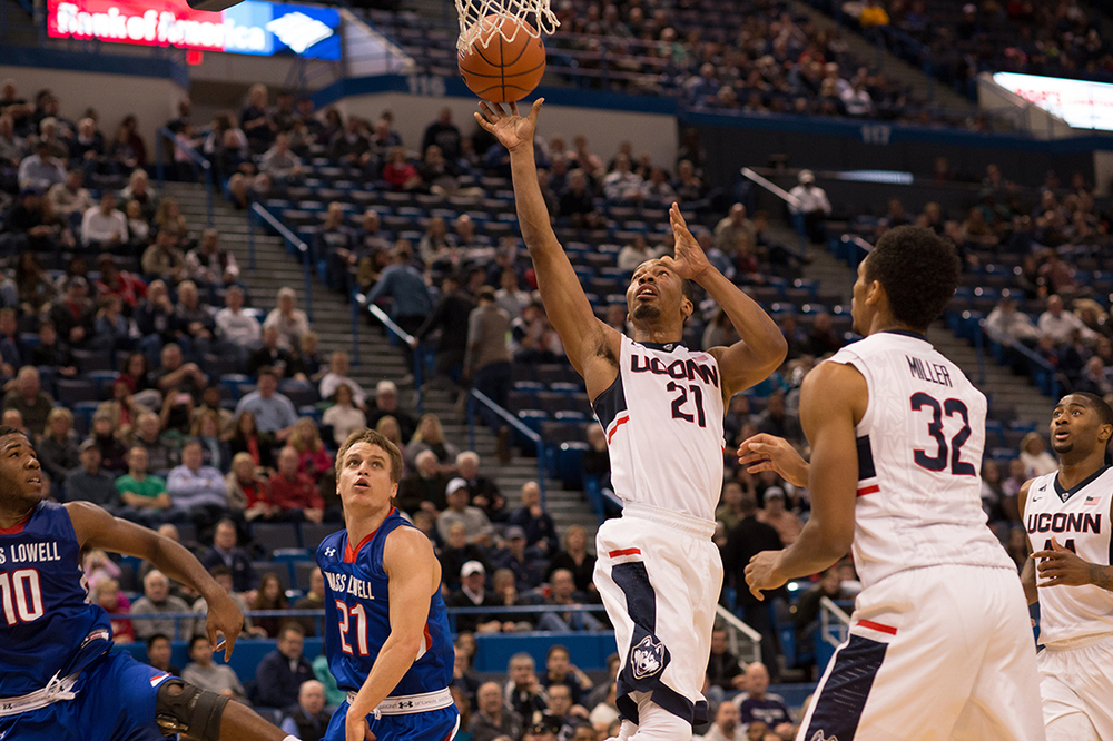 Omar Calhoun (#21) rises for a layup during UConn's 88-79 victory over UMass-Lowell Sunday afternoon at the XL Center. Calhoun has made seven consecutive field goals, stretching over his last two games. He scored 14 points in each. (Jackson Haigis/The Daily Campus)