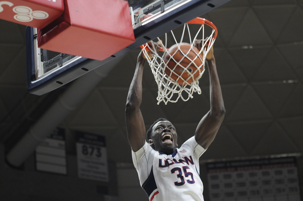 Amida Brimah throws down a dunk during UConn's win over UNH on Nov. 17. According to the school, Brimah will miss 6-8 weeks with a broken finger. (Bailey Wright/The Daily Campus)