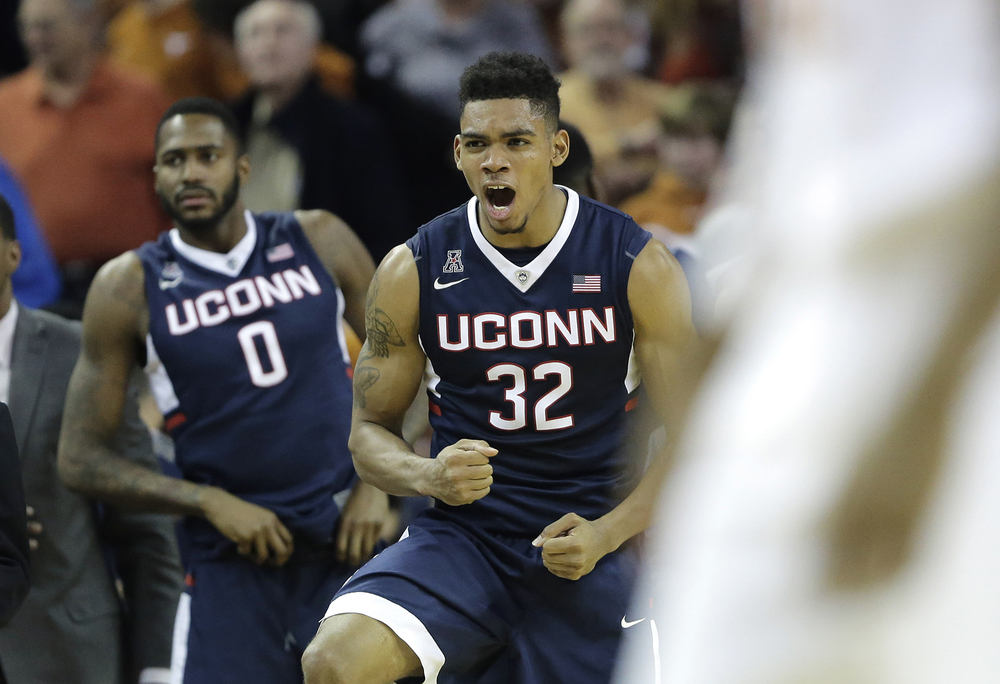 Connecticut forward Shonn Miller (32) celebrates the team's win over Texas in an NCAA college basketball game Tuesday, Dec. 29, 2015, in Austin, Texas. Connecticut won 71-66. (AP Photo/Eric Gay)