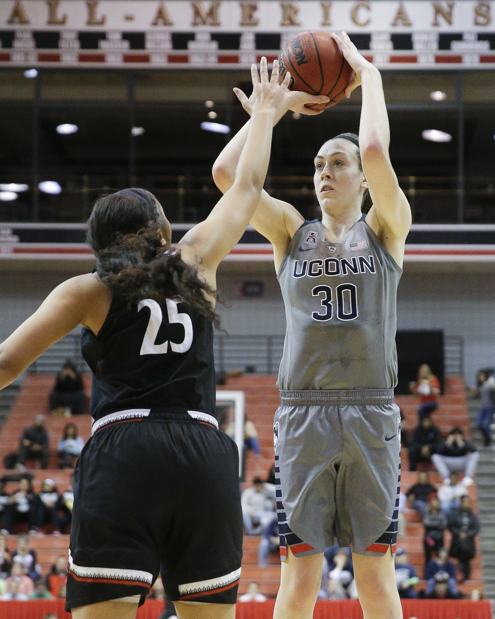 Connecticut's Breanna Stewart (30) shoots over Cincinnati's Chelsea Warren (25) in the first half of an NCAA college basketball game, Wednesday, Dec. 30, 2015, in Cincinnati. (AP Photo/John Minchillo)