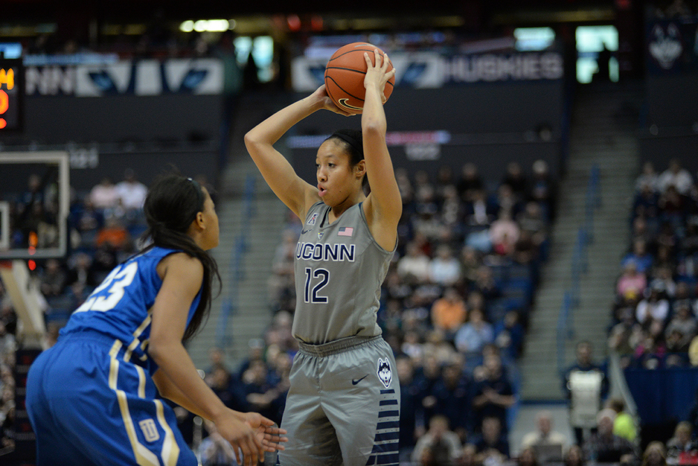 UConn women's basketball guard Saniya Chong looks for a pass during the Huskies' game against Tulsa in Hartford, Connecticut on Wednesday, Jan. 6, 2016. Chong, filling in for injured point guard Moriah Jefferson scored a season-high 18 points in the 95-35 victory. (Ashley Maher/The Daily Campus)