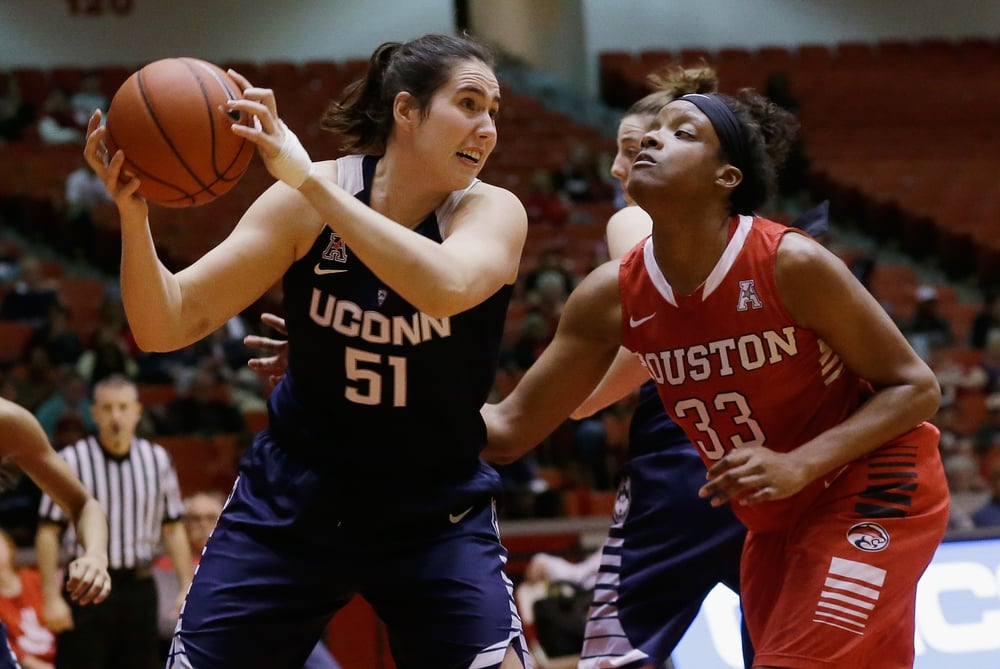 Connecticut center Natalie Butler (51) grabs a rebound from Houston forward Tyler Gilbert (33) during the second half of an NCAA college basketball game Friday, Jan. 8, 2016, in Houston. (Bob Levey/AP)