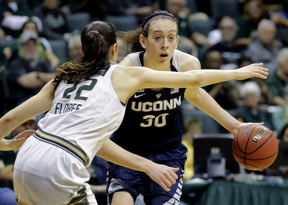 Connecticut forward Breanna Stewart (30) dribbles around South Florida guard Laia Flores (22) during the second half of an NCAA college basketball game Sunday, Jan. 10, 2016, in Tampa, Fla. Connecticut won 75-59 (Chris O'Meara/AP)