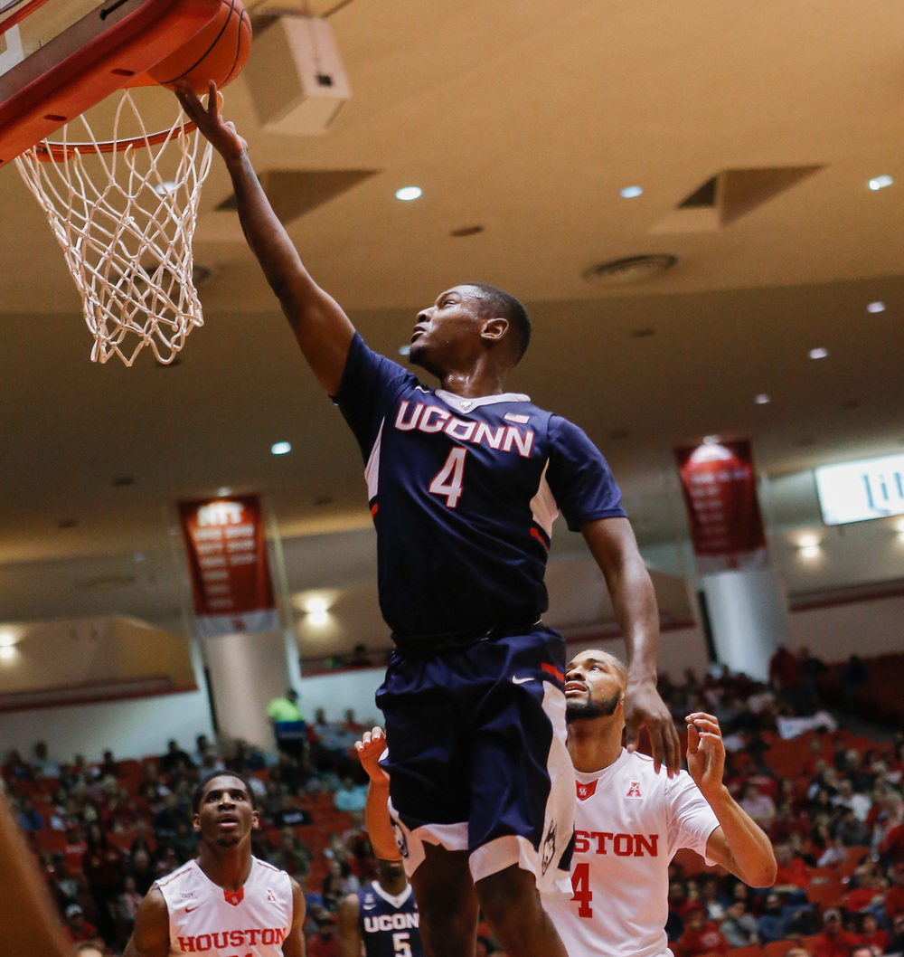 Connecticut guard Sterling Gibbs (4) drives to the basket for a layup past Houston guard LeRon Barnes (4) during the first half of an NCAA college basketball game Sunday, Jan. 17, 2016, in Houston. (AP Photo/Bob Levey)