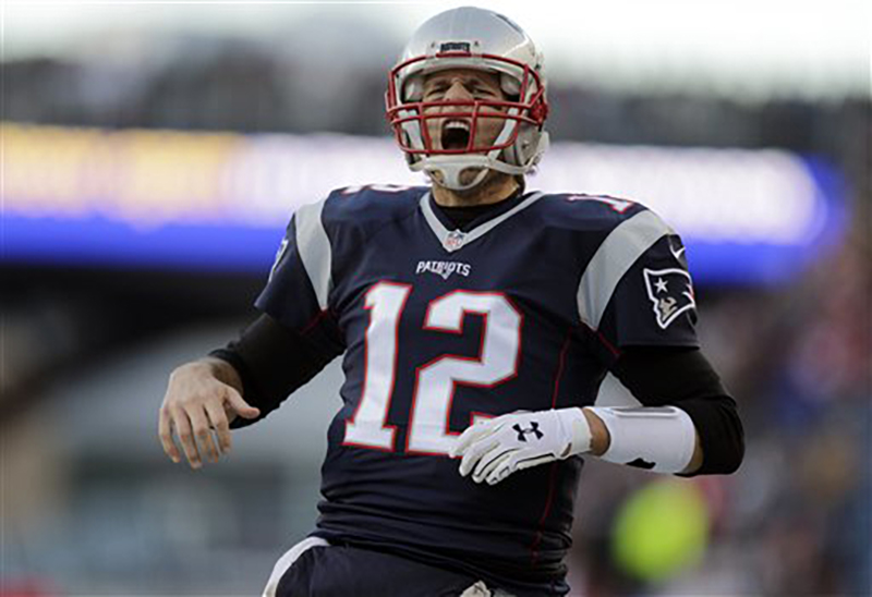 New England Patriots quarterback Tom Brady shouts as he takes the field to warm up before an NFL divisional playoff football game against the Kansas City Chiefs, Saturday, Jan. 16, 2016, in Foxborough, Mass. (AP Photo/Charles Krupa)