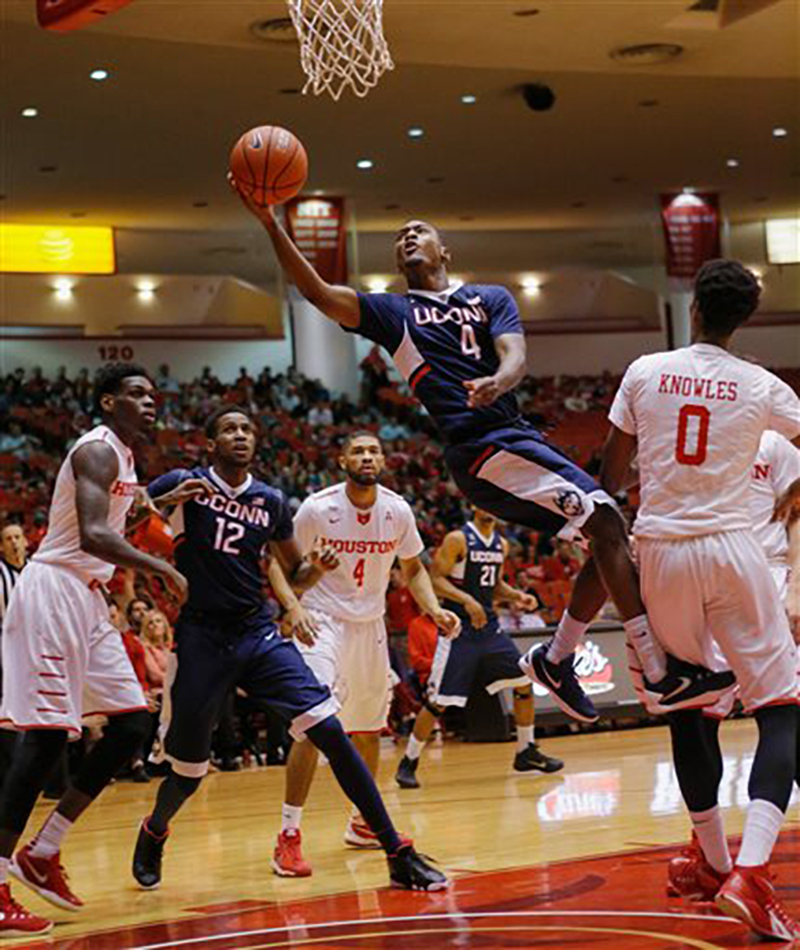 Connecticut guard Sterling Gibbs (4) drives to the basket for a layup past Houston forward Danrad Knowles (0) during the first half of an NCAA college basketball game Sunday, Jan. 17, 2016, in Houston. (AP Photo/Bob Levey)