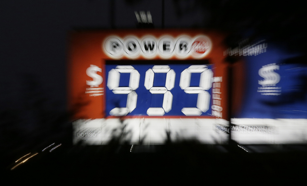 A focus shift combined with a slow camera shutter creates a blur of a sign advertising the jackpot for the Powerballlottery in downtown Dallas, Wednesday, Jan. 13, 2016. The Powerball jackpot for Wednesday night's drawing is at least $1.5 billion, the largest lottery jackpot in the world. (AP Photo/LM Otero)