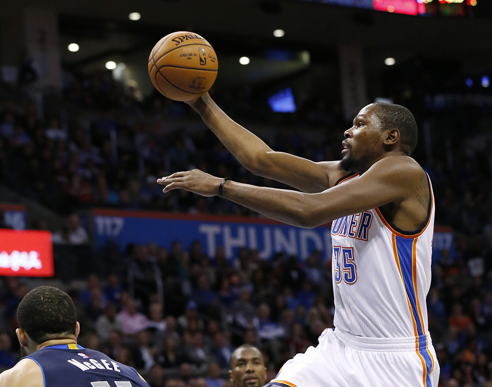 Oklahoma City Thunder forward  Kevin   Durant  (35) goes up for a shot during the third quarter of an NBA basketball game against the Dallas Mavericks in Oklahoma City, Wednesday, Jan. 13, 2016. Oklahoma City won 108-89. (AP Photo/Sue Ogrocki)
