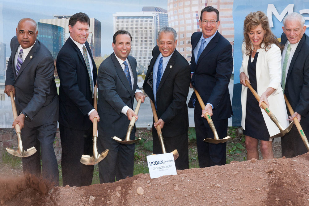 State senators, Governor Dannel Malloy, UConn President Susan Herbst and other officials took part in the groundbreaking of UConn's new downtown Hartford campus in May 2015. On Jan. 12, UConn announced that it will grant $5,000 scholarships to Hartford Promise students who plan to enroll at UConn, a program that the university hopes will generate interest in the Hartford campus. (CT Senate Democrats/Flickr)