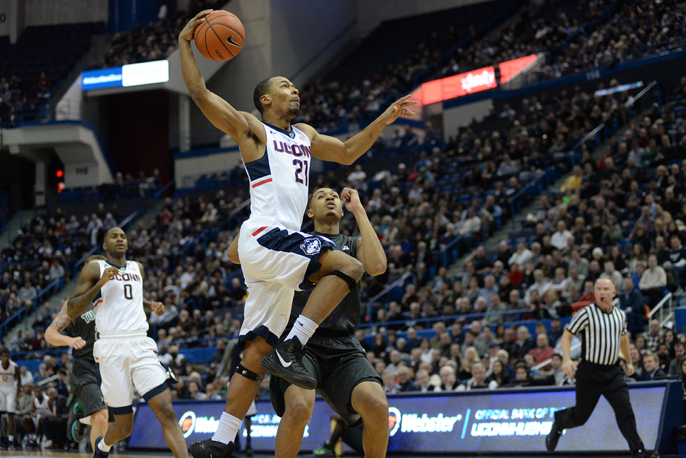 UConn men's basketball guard Omar Calhoun goes up for a layup during the Huskies' game against Tulane at the XL Center in Hartford, Connecticut on Tuesday, Jan. 19, 2016. (Ashley Maher/The Daily Campus)