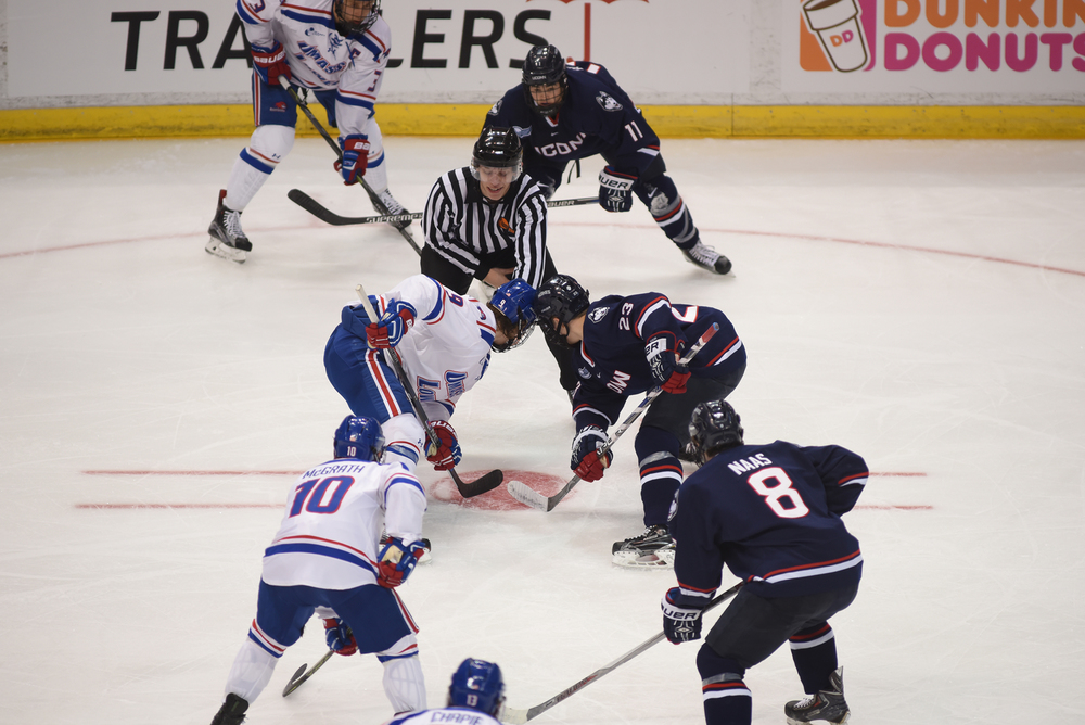 UConn sophomore forward Kasperi Ojantakanen (23) prepares to take a faceoff during the Huskies' game against UMass-Lowell at the XL Center in Hartford, Connecticut on Saturday, Dec. 5, 2015. (Zhelun Lang/The Daily Campus)