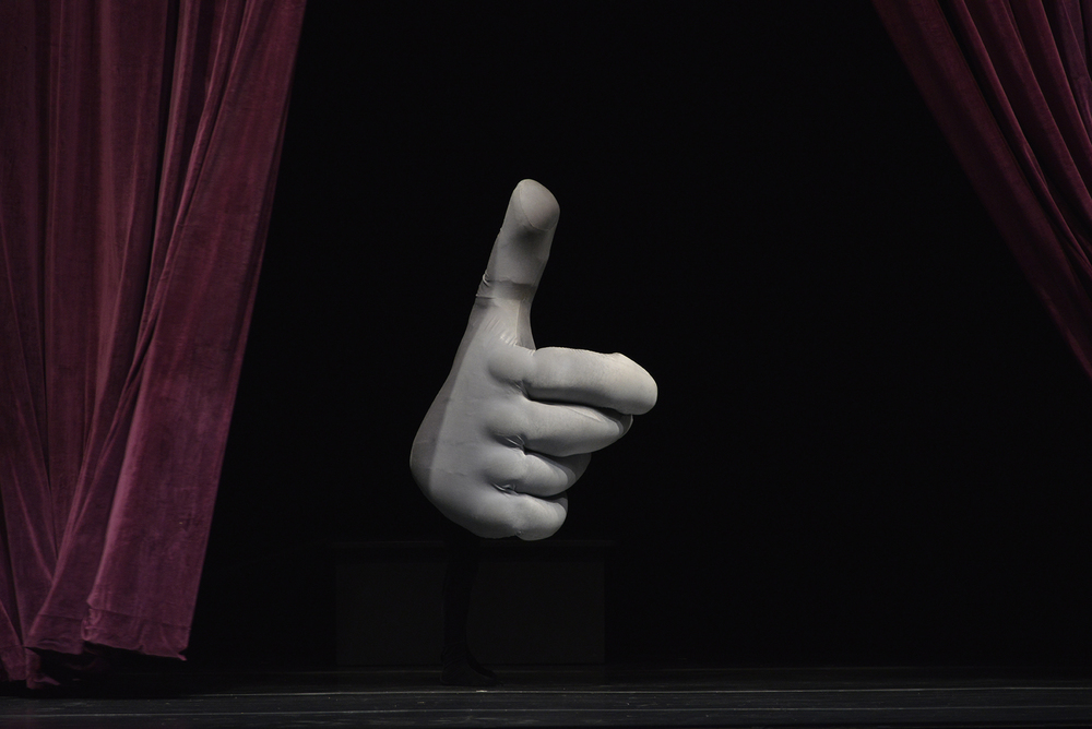 A hand extends out from a curtain during a performance by Swiss theatrical group Mummenshanz at the Jorgensen Center for the Performing Arts in Storrs, Connecticut on Friday, Jan. 22, 2016. (Jason Jiang/The Daily Campus)