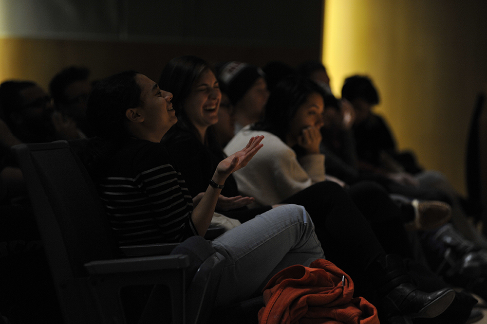 Audience members are seen laughing during an improv comedy showcase in the Student Union Theatre on Friday, Jan. 22, 2016. (Jason Jiang/The Daily Campus)