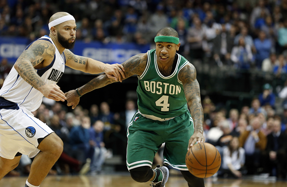 Dallas Mavericks guard Deron Williams (8) defends as  Boston   Celtics  guard Isaiah Thomas (4) controls the ball during overtime of an NBA basketball game, Monday, Jan. 18, 2016, in Dallas. Dallas won 118-113. (AP Photo/Sharon Ellman)