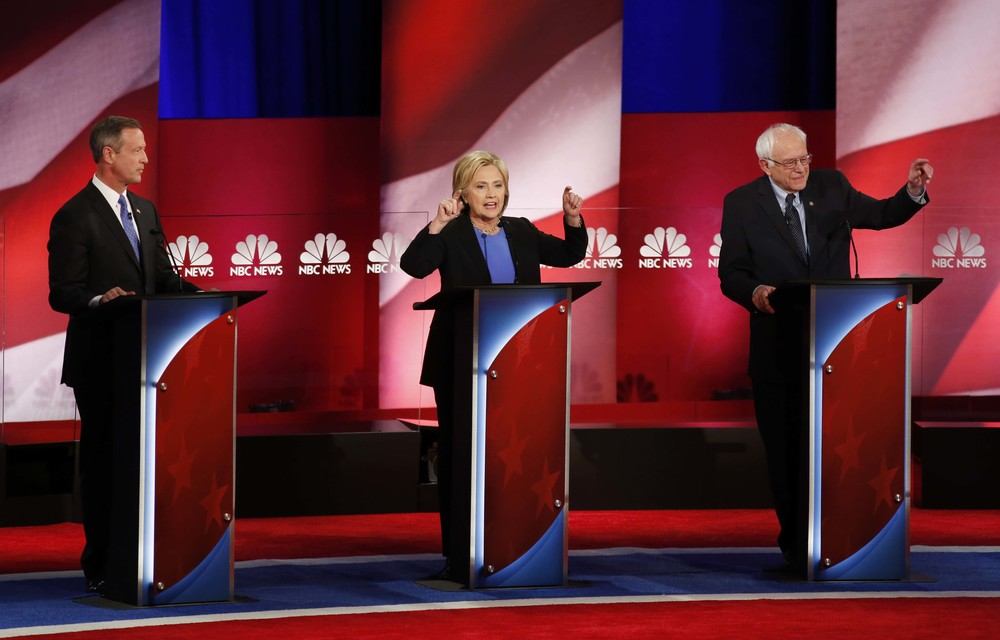 Democratic presidential candidate, former Maryland Gov. Martin O'Malley , left, listens to Democratic presidential candidates, Hillary Clinton and Sen. Bernie Sanders, I-Vt, speak, during the the NBC, YouTube Democraticpresidential debate at the Gaillard Center, Sunday, Jan. 17, 2016, in Charleston, S.C. (AP)