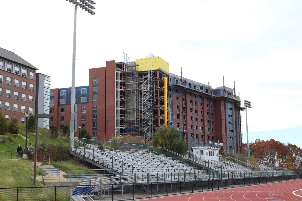 In this photo, the new STEM dorm is seen under construction behind the Sherman Family Sports Complex in Storrs, Connecticut on Monday, Nov. 2, 2015. The ScHOLA2RS House will be located here. (Jackson Haigis/The Daily Campus)