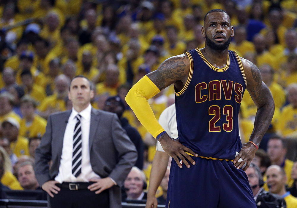 n this June 7, 2015, file photo, Cleveland Cavaliers forward  LeBron   James  stands on the court near coach David Blatt during Game 2 of basketball's NBA Finals against the Golden State Warriors in Oakland, Calif.  James ' calculating image wasn't helped when the Cavaliers stunningly fired Blatt on Friday, Jan. 22. (AP Photo/Ben Margot, File)