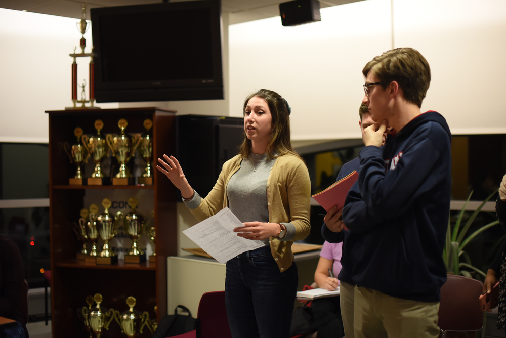 Stephanie Sponzo and Daniel Byrd address the caucus. (Zhelun Lang/Daily Campus)