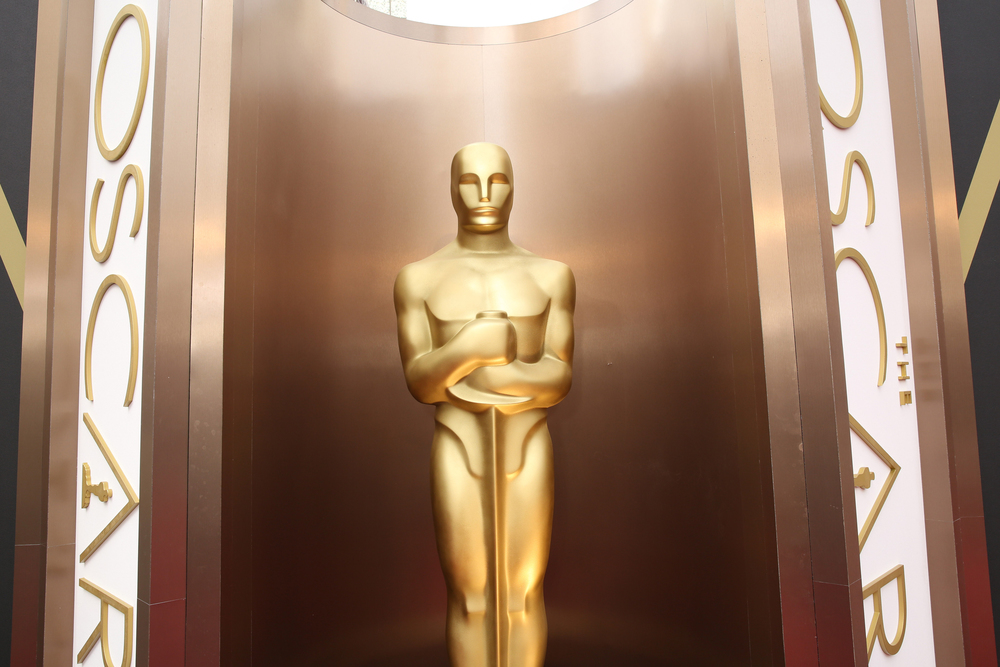 In this March 2, 2014 file photo, an Oscar statue is displayed at the Oscars at the Dolby Theatre in Los Angeles. Since the Academy of Motion Pictures Arts and Sciences said that it was altering membership rules in response to an outcry over the diversity of its voters and of its nominees, another uproar has erupted around Hollywood. (Matt Sayles/Invision/AP, File)