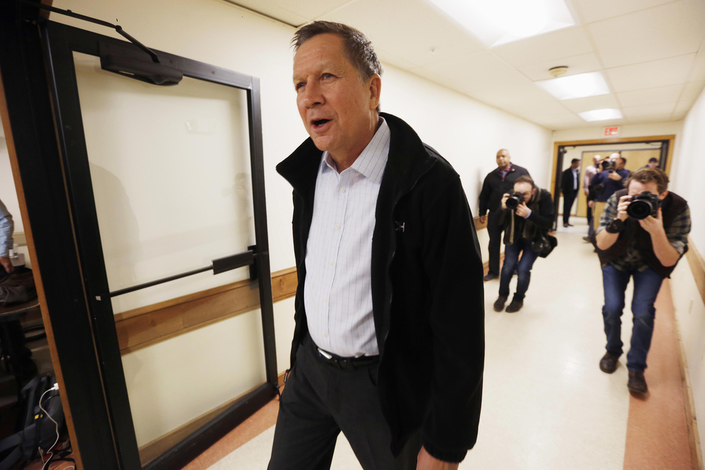 Republican presidential candidate, Ohio Gov. John Kasich walks into a town hall campaign stop before next weeks earliest in the nation presidential primary, Monday, Feb. 1, 2016, in Rochester, N.H. (Jim Cole/AP)