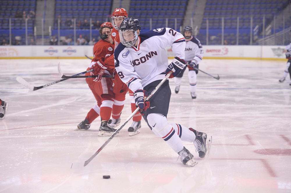 UConn men's ice hockey forward Tage Thompson handles the puck during the Huskies' game against Sacred Heart at XL Center in Hartford, Connecticut on Tuesday, Jan. 26, 2016. (Jason Jiang/The Daily Campus)