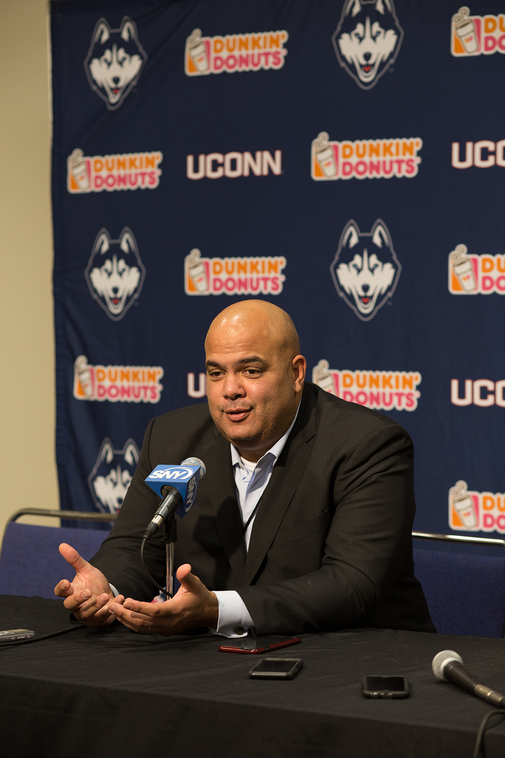 University of Connecticut athletic director Warde Manuel speaks at a press conference at halftime of the UConn women's basketball game against Memphis at the XL Center in Hartford, Connecticut on Jan. 30, 2016. (Jackson Haigis/The Daily Campus)