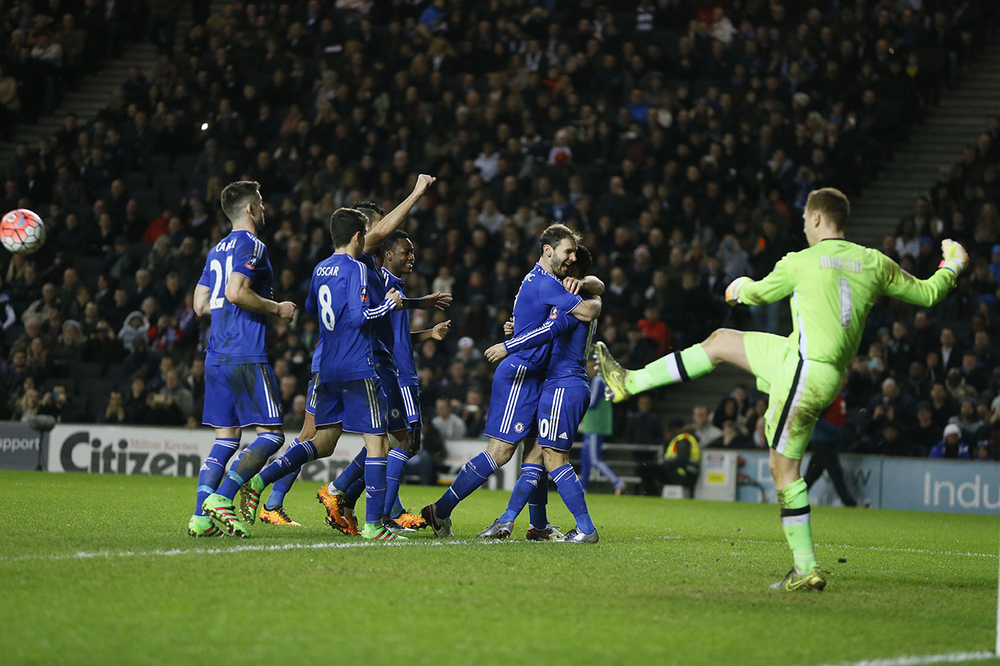 Chelsea's Eden Hazard, second right, celebrates scoring a penalty kick during the English FA Cup fourth round soccer match between Milton Keynes Dons and Chelsea at Stadium mk in Milton Keynes, England, Sunday, Jan. 31, 2016. (AP Photo/Kirsty Wigglesworth)