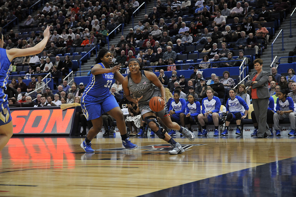 Forward Morgan Tuck blows by her defender during UConn's victory over Tulsa. Tuck should consider her options when it comes to going to the WNBA. (Ashley Maher/The Daily Campus)