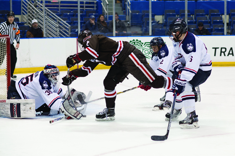 Steve Thulin makes a save against Brown during Tuesday's victory at the XL Center. (Jackson Haigis/The Daily Campus)