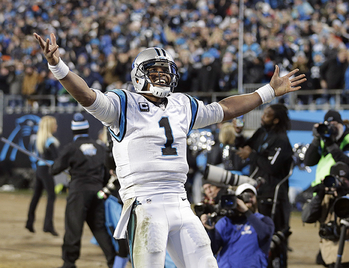 Carolina Panthers' Cam Newton celebrates a touchdown pass during the second half the NFL football NFC Championship game against the Arizona Cardinals Sunday, Jan. 24, 2016, in Charlotte, N.C. (AP Photo/Chuck Burton)