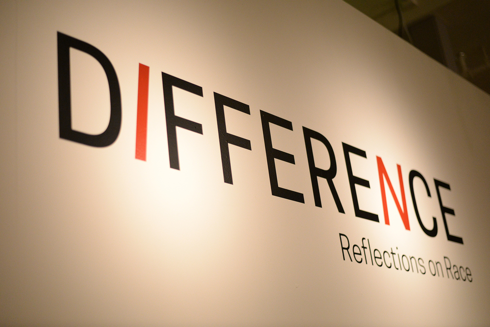 """The museum's interactive exhibit entitled, """"Difference: Reflections on Race,"""" features a large poster on the wall in which students can take color-coded stickers representing their viewpoints: """"neutral,"""" """"disagree"""" or """"agree""""; place them in different boxed-in statements. (Ashley Maher/Daily Campus)"""