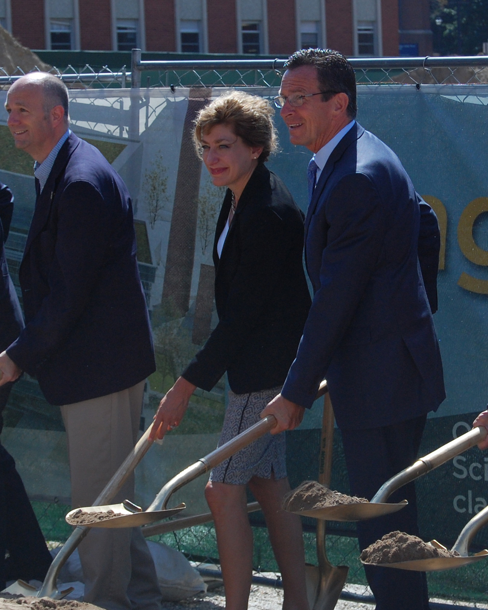 UConn President Susan Herbst and Connecticut Governor Dannel P. Malloy are seen shoveling at the breaking ground of the new engineering and science building on Sept. 9, 2015 (Ashley Maher/The Daily Campus)