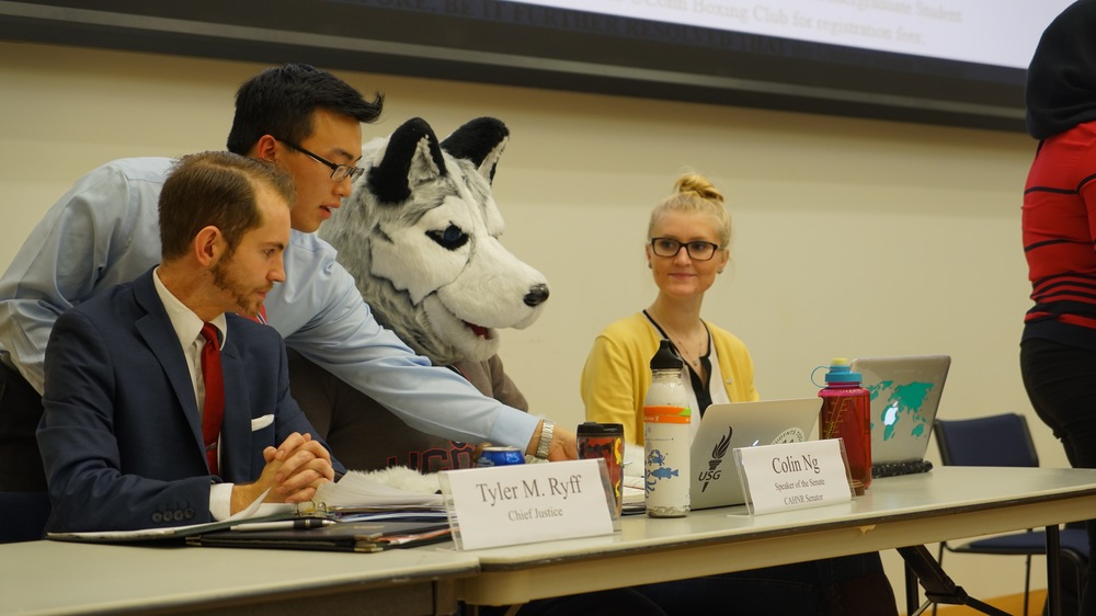 The funding board discusses proposals with Jonathan at the Feb. 3 meeting. (Erming Gao/Daily Campus)
